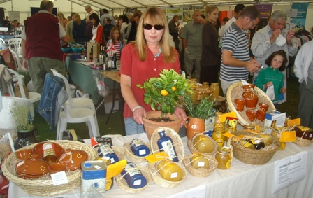 Pyreneeshoney Market Stall Showing Ceramics and Olive Oil as well as Honey
